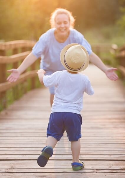 Child rushing to mom's outstreched arms