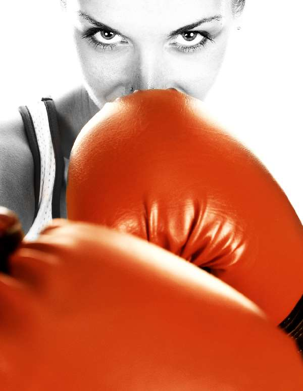Woman with red boxing gloves on signifying you should choose your battles wisely in a divorce