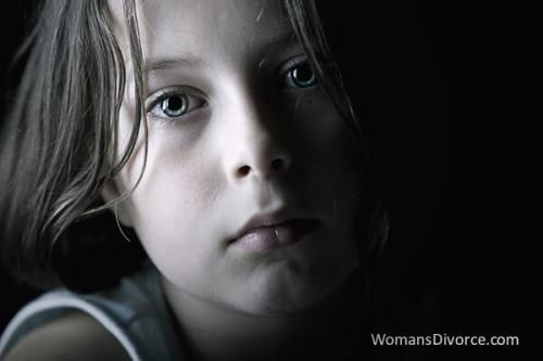 Sad little girl living with domestic violence