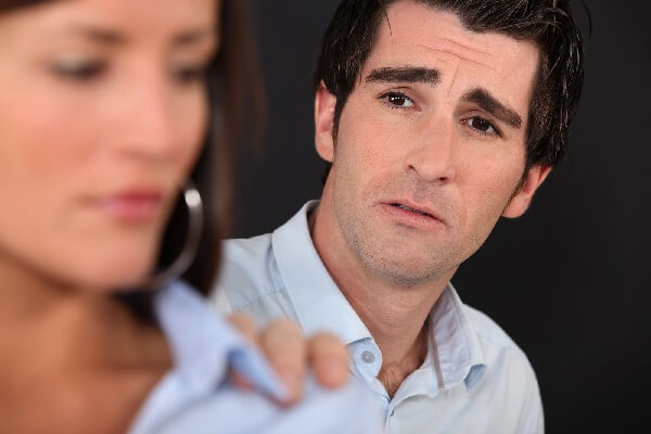 Man reaching out to wife asking forgiveness after an affair