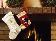 Two stockings hanging from the fireplace mantle