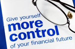 Glasses on booklet discussing how to control your financial future