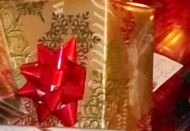 Shiny red bow on gold package
