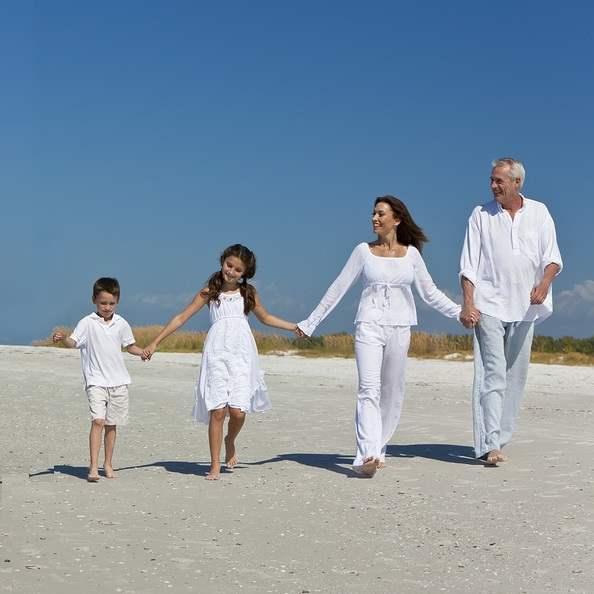 Grandparents enjoying visitation time with grandchildren on the beach