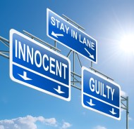Street sign depicting lanes for innocence and guilt