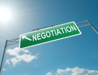 Negotiation street sign