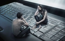 Cyber romance concept of couple sitting on laptop
