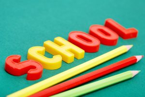 The word school spelled out with refrigerator magnets