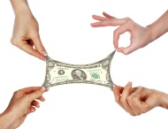 Women's hands stretching money to make ends meet