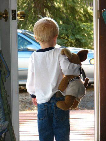 Little boy with stuffed animal waiting for visitation