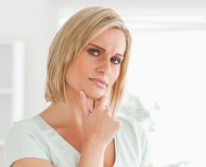 Woman with a wondering expression on her face