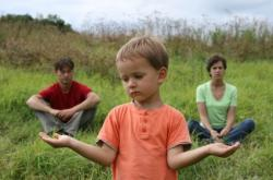 Little boy having to choose between Mom and Dad