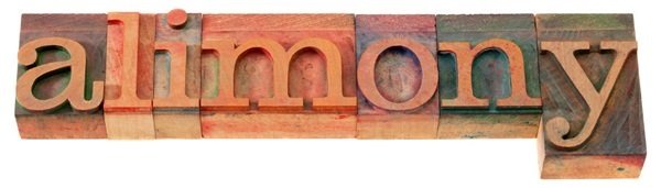 Alimony spelled out with letterpress blocks