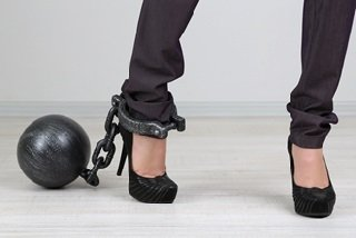 Professional woman chained to manimony