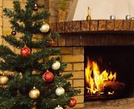 Christmas tree next to fireplace