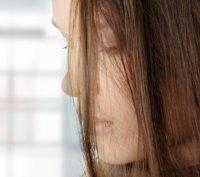 Depressed woman looking down