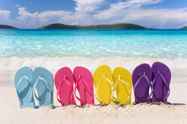 Flipflops in the sand on a beach - vacation ideas for divorced parents