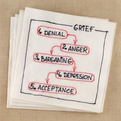 stages of grief written out on napkin
