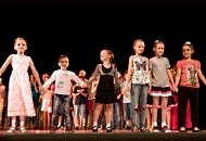 group of small children on school stage