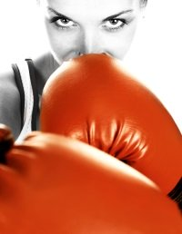 Woman with red boxing gloves on